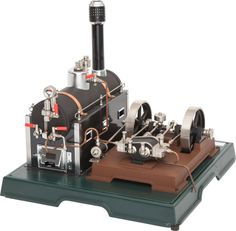 MARKLIN MODEL LIVE STEAM TOY STATIONARY ENGINE 13-1/2 x 14-1/2 x 14-1/2 inches (34.3 x 36.8 x 36.8 cm) Large and well engineered Marklin toy with horizontal boiler and double fly wheel engine.