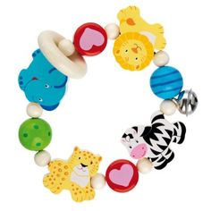 The Heimess Touch Ring Rattle Elastic Africa is a traditional wooden toy made in Germany. Heimess toys are made of hardwoods such as beech and sycamore, sustainably harvested from select German forests. Baby Mama Quotes, Baby Daddy Shirt, Baby Alive Food, Early Learning Activities, Wooden Baby Toys, Baby Rattle, Baby Games, Baby Store, Vibrant Colors