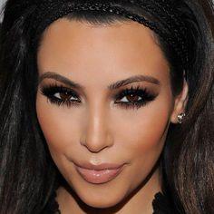 Kim Kardashian dark smokey eyes and nude lips