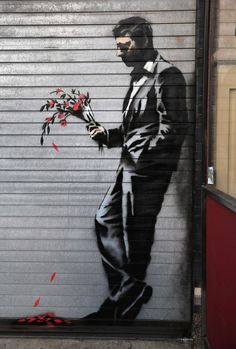 Banksy: Waiting - painted on the shutters of a strip joint