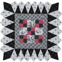 Make a one-block table topper that has an intricate ice cream cone border.  Using the Traditions of Redwork, Blackwork, Indigo collection by Henry Glass  & Co. resulted in a graphic two-color quilt with just a hint of red.