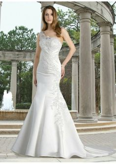 This 2012 new-style dress features its asymmetrical neckline and one-shoulder strap lace applique accents mermaid skirt with chapel train.