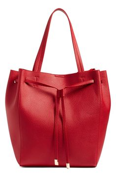Welcoming fall with this gorgeous red drawstring tote from the Anniversary Sale.