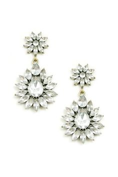 These vintage inspired statement earrings feature clear cut gems in an intricate floral motif. The drops are approximately 2 inches in length.