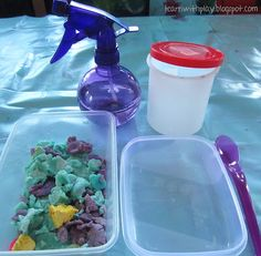 Dried play dough and water (useful for garbage playdough). → Materials: dried play bough bits, water in squirter, container with lid, open container, and spoon.