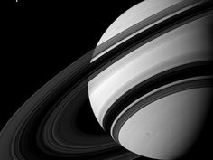 """Saturn's moon Tethys is the tiny dot in the upper left. It's several times more massive than all of the rings put together, but the rings are much more diffuse. This image was taken with Cassini's wide-angle camera on Aug 19 2012. It was below the ring plane looking at the unlit side of the rings. ©Mona Evans, """"10 Amazing Facts about Saturn's Moons"""" http://www.bellaonline.com/articles/art28136.asp"""