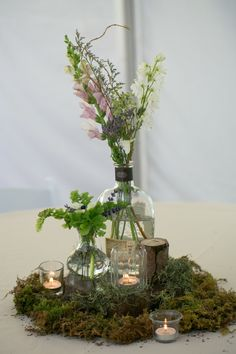 Repurposed bourbon bottles, moss, ferns, and wood pieces made up our wedding centerpieces! Photo By Ben Elsass Photography Moss Centerpiece Wedding, Moss Centerpieces, Bottle Centerpieces, Moss Wedding Decor, Centerpiece Ideas, Moss Decor, Natural Wedding Decor, Enchanted Forest Wedding, Boho Wedding