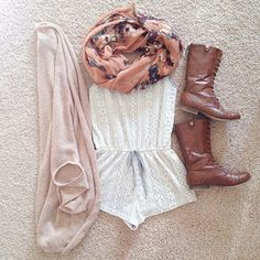 Pair your romper with a scarf and combat boots for an outfit that's perfect for spring or fall weather.