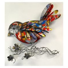 This unique Recycled Metal Bird on Branch Wall Art will add a touch of whimsy and a splash of color to your walls!