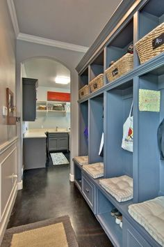 This stylish yet functional mudroom is equipped with individual storage space for each family member. The utility room helps a growing family stay neat and organized.