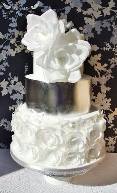 Romeo & Juliet Cakes - lisa wedding cake, edible silver leaf, and pure white rice (wafer) paper flowers (roses, ranuculi and blossoms).