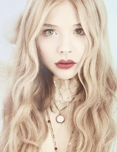 Chloe Moretz, red lips, porcelain skin, curly blonds and vintage necklaces