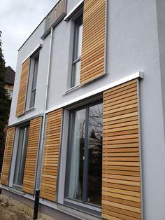 Volets coulissants modernes en bois avec des systèmes MANTION®. Rendez-vous sur le site pour en savoir plus !