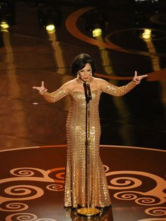 Shirley Bassey  Shirley Bassey is drenched in gold as she sings her signature Bond song.