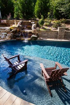 The Werners were interested in adding a pool, spa, kitchen, and waterfall to one side of their property, and they also wanted the space to be accessible to a. Backyard Pool Designs, Swimming Pools Backyard, Large Backyard, Pool Spa, Swimming Pool Designs, Pool Landscaping, Backyard Ponds, Backyard Kitchen, Backyard Ideas