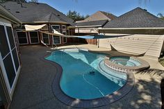 Spectacular pool with sun shade sails. #FirstMarketRealty #BrokerJodi #HoustonRealEstate