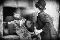 """chaplin-images-videos: """" Charlie Chaplin in The Kid """" The most marvelous spit I've seen in my life! I think this should be the first step of a major undertaking the aim of which is to screenshot every spit of Charlie :D!"""