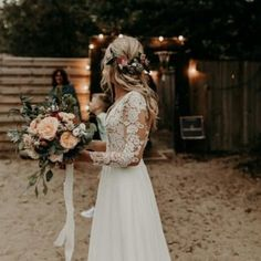 Apr 2, 2020 - Feel dreamy in this feminine chiffon A-line wedding gown. The illusion V-neckline with lace appliques on the sleeves make this look romantic. V Neck Wedding Dress, Cute Wedding Dress, Dream Wedding Dresses, Perfect Wedding, Fall Wedding, Bridal Dresses, Chic Wedding, Vintage Boho Wedding Dress, Bohemian Style Wedding Dresses