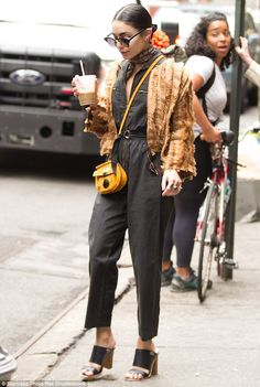 Pop of colour: Vanessa brightened up her look with a mustard yellow crossbody bag...