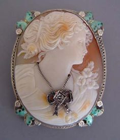 Antique cameo with aqua enameled butterflies and a diamond necklace