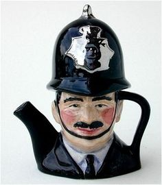 London Bobby Miniature Teapot made by Acorn Pottery @ Stoke on Trent, UK.