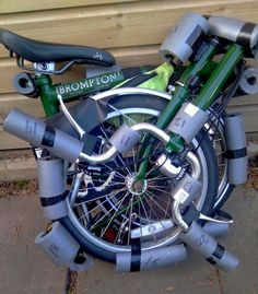 Transporting A Brompton by Dimpa: Step 1. Strategically place pipe insulation foam around bike, using tape or velcro to keep the foam in place.