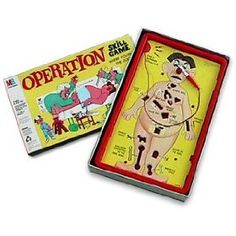 OPERATION Board Game Kissing Game -  Come up to the front, pull out a card with a body part on it, if they can pull the part out, the couple kisses, if they buzzer goes off, they kiss their date's body part