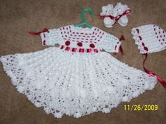 baby outfit includes dress,booties, bonnet, and baby afghan