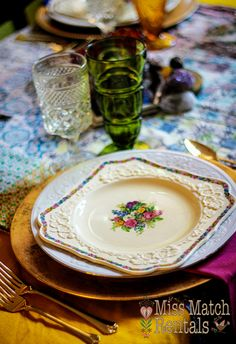 Gypsy chic table setting, colored vintage goblets, gold charger, and 1950's quilt top linen