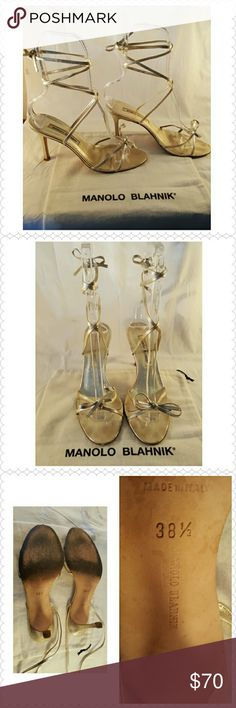 """MANOLO BLAHNIK SAHARA GOLD TIE SANDAL WITH BOX Sexy, delicate, thin& strappy! Bring out your inner goddess with these sassy gold sandals. Crisscrossing straps top a sleek slide sandal set on a sexy slim heel. 4"""" heel ITALIAN Size 38 1/2 US 8.This designer runs up to a half size to one size smaller than most. Add 30.5 to your US shoe size to determine fit. Metallic Leather or textile upper/leather lining and sole. Salon Shoes.These beauties have been pre-loved &have imperfections.See comments…"""