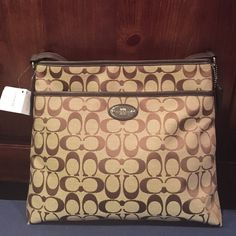 "Coach Signature Crossbody File Bag. Brown/Tan Coach Signature bag. Tan material with brown signature Coach ""C"" logo design. Piping, strap and side detail all done in chocolate brown leather. Approx. dimensions: Width: 11 1/2"" x L: 10 1/2"". Beautiful bag. Coach Bags Crossbody Bags"