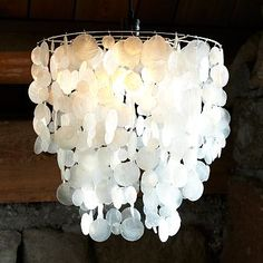 West Elm has tons of really great and fabulous decor items that would look terrific in almost any home. But sometimes you can't spend a ton of money and don't need to splurge on a simple piece in West Elm. You can DIY your own. West Elm Chandelier, Capiz Shell Chandelier, White Chandelier, Shell Lamp, Circular Chandelier, Pendant Lighting Bedroom, Home Lighting, Lighting Ideas, Kitchen Lighting