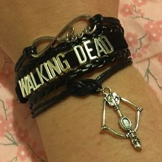 "The Walking Dead✨5 available✨ Obsessed with The Walking Dead? This bracelet is for u! This measures about 7"" plus it has a chain extender and lobster clasp on the back. New in package. Firm unless bundled. Jewelry Bracelets"