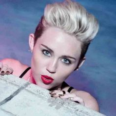 Miley Cyrus' new music video for 'We Can't Stop' is filled with gloriously WTF moments. Watch it here.