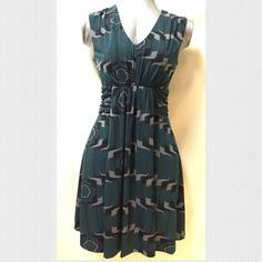 Banana Republic Print Dress Banana Republic print dress with dark green, gray, and black pattern. Ruched waistline. Soft and flowy A-line dress. Never worn - in excellent condition. Banana Republic Dresses Midi