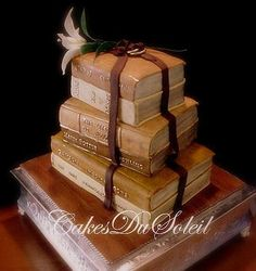 Sculpted book cake. I'd really like our wedding cake to be a stack of books - preferably with the top book open and a castle cake topper. Many other book cakes on this site, but this is the best.