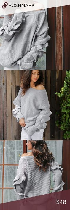 Oversized Ruffle Sleeve Sweater New with tags! Oversized. One Size Fits small to large. Soft, warm fabric. Perfect sweater to look cute and feel cozy in!  Offers welcome! Sweaters