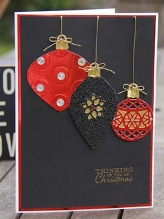 handmade Christmas card by Stampin Up UK Demonstrator Zoe Tant ... luv the black background with the red foil and black glitter paper die cut ornaments ... fab look ...