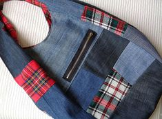 Handmade denim slouchy sack hobo bag. Casual, Rock, Punk, Grunge, Street style, Urban fashion. Grab and go! Denim plus tartan patchwork. Tartan red lining. Zipped pocket outside + open pocket inside. Magnetic closure. Machine washable. Made of recycled denim. I do my bit to save the