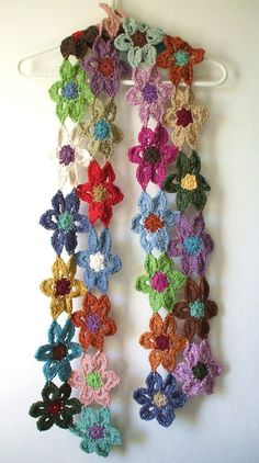 Crochet flower scarf:  This is for purchase, not a pattern, BUT it would be simple enough to take your favorite FREE flower pattern and whip it into something fabulous (or hideous depending on your point of view) like this! :)