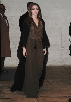 Pin for Later: 52 Reasons to Celebrate Angelina Jolie's Red Carpet Evolution Angelina Jolie's Red Carpet Transformation For the Women in the World Summit in 2013, Angelina looked elegant in a modest Saint Laurent look.