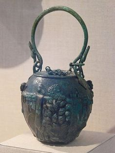 Bronze balsamarium (flask to carry oil to use to clean the skin after exercise) decorated with lions' skins and herms Roman late 1st-2nd century CE