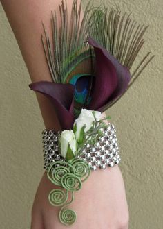 flowers aside, times have changed and most florist offer a great alternative to a wrist corsage. Many come in pearls or other tones. Its more comfortable and definitely keeps up with the times. Peacock Theme, Peacock Wedding, Mother Of The Bride Flowers, Buquet, Corsage And Boutonniere, Boutonnieres, Feather Boutonniere, Prom Flowers, Wedding Flowers