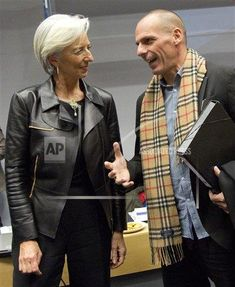 Managing Director of the International Monetary Fund Christine Lagarde, left, speaks with Greek Finance Minister Yanis Varoufakis during a meeting of eurogroup finance ministers in Brussels, Belgium on Wednesday, Feb. 11, 2015. Leading European officials downplayed expectations that a comprehensive debt deal with Greece is likely Wednesday at an emergency meeting in which Greece's finance minister is set to unveil a plan to loosen