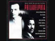 Philadelphia, written and performed by Neil Young.  He wrote this song at the request of the director, Jonathon Demme.  The song plays at the end of the movie when everyone is gathering for Andy's memorial. It is a hauntingly beautiful song with wonderful lyrics.