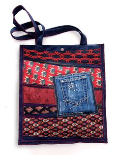 Super bag - Denim bag with upcycled ties in the front. With higher internal and lower external pocket. Dimensions approximately 36 x 41 cm. The length of the handle 62 cm. One and only. 37.00 €