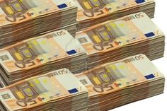 Stacks of 50 euro bills, isolated on white Stock Photo