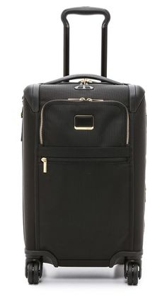 Tumi International 4 Wheel Carry On Luggage, or should i get this one.