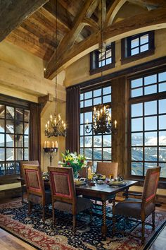 I love the chandeliers hanging from the super high ceilings.  Oh...and the windows aren't so shabby either!