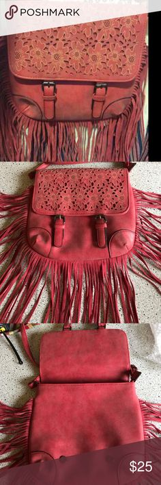 "NWT boho fringe cross body bag w/ flower detail Flower detail on the front flap. Flap snaps closed. Zipper pocket in back. Inside has 2 slip and 1 zip pocket. No tag stating it's leather so I assume it's not. Can also be a cross body. Approx 10x11"" not incl fringe. Approx 21"" strap drop which can be made shorter. Unbranded. Bags Crossbody Bags"